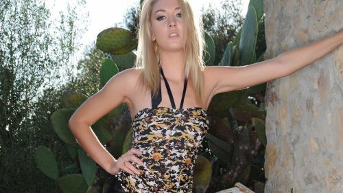 Charlotte M teasing in animal print top & black panties